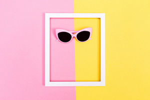 Sunglasses and frame on bright duotone background