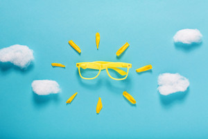 Sunshine sunglasses concept on a blue sky background
