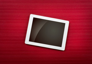 Tablet with isolated screen on red carpet
