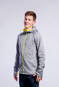 Teenage boy in gray sports jacket, young man, studio shot on gray background