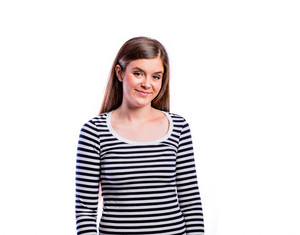 Teenage girl in black striped longsleeved t-shirt, young beautiful woman, studio shot on white background, isolated