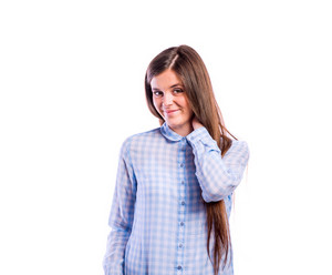 Teenage girl in blue checked shirt, holding neck, young beautiful woman, studio shot on white background, isolated