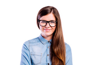 Teenage girl in blue denim shirt and trendy black eyeglasses, young beautiful woman, studio shot on white background, isolated