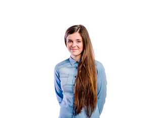 Teenage girl in blue denim shirt. Young beautiful woman, studio shot on white background, isolated.