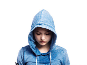 Teenage girl in blue sweatshirt, hood on head. Beautiful young sportswoman, studio shot on white background, isolated.