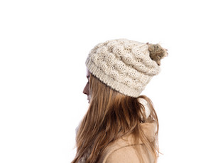 Teenage girl in brown winter coat and woolen scarf and hat, young woman, studio shot on white background. Isolated.