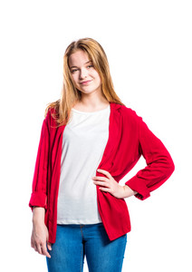 Teenage girl in jeans and red jacket, young woman, studio shot on white background, isolated