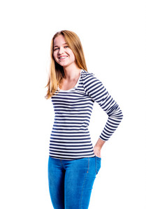 Teenage girl in jeans and striped long sleeved t-shirt, young woman, studio shot on white background, isolated