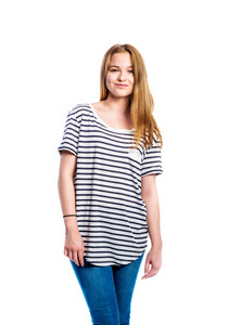 Teenage girl in jeans and striped t-shirt, young woman, studio shot on white background