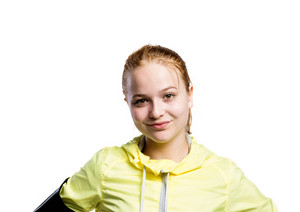Teenage girl in neon yellow running jacket, wearing phone armband. Beautiful sportswoman. Studio shot on white background, isolated.