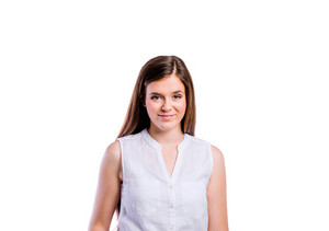 Teenage girl in white sleeveless shirt, young beautiful woman, studio shot on white background, isolated