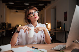 Thoughtful office woman. in glasses