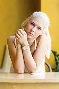 Thoughtful teenage girl with beautiful blue eyes