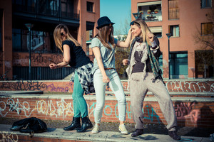 three beautiful friends authentic in urban contest dancing