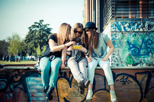 three beautiful friends authentic in urban contest