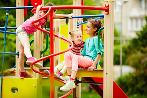 Three girls playing together on playground