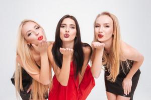 Three models in dresses. send air kiss