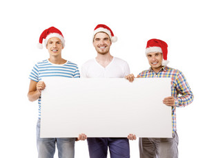 Three young men in santa hats with copy space, isolated on white background