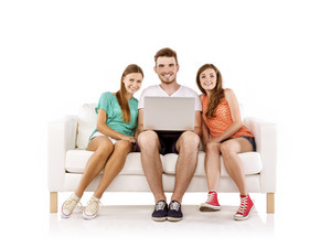 Three young people sitting on sofa and using laptop, isolated on white background. Best friends