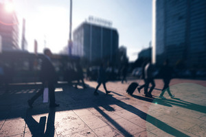 Tilt shift of people walking outdoor on the sidewalk in the city - commute, work concept
