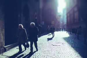 Tilt shift vintage filtered of people walking outdoor in the street of the city center  - commute, work, strolling concept