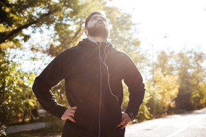 Tired male runner in park. image from below