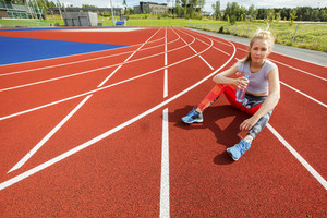 Tired Woman Holding Water Bottle On Running Tracks