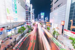 TOKYO - JUNE 7: Traffic passes under a bridge outside Shinjuku station, Shinjuku, Tokyo, Japan.