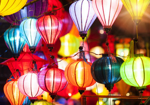 Traditional colorful silk lanterns at market street in Vietnam.