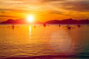 Traditional philippino boats at El Nido bay in sunset lights. Palawan island, Philippines