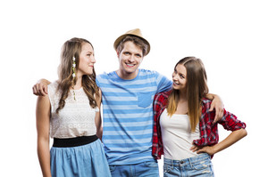 Trendy teenagers posing. Studio shot on white background