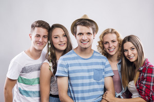 Trendy teenagers posing. Studio shot on white background.