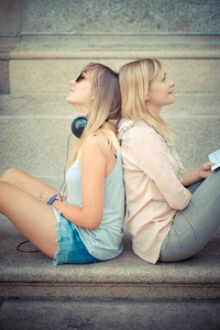 two beautiful blonde woman relaxing in the city