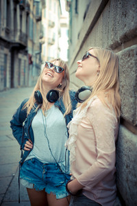 two beautiful blonde women in the city