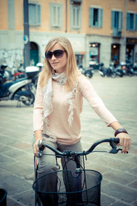 two beautiful blonde women shopping on bike in the city