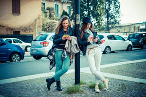 two beautiful friends authentic in urban contest