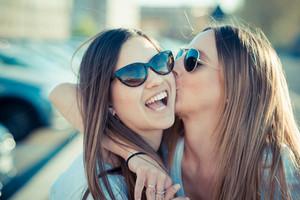 two beautiful young women having fun in the city