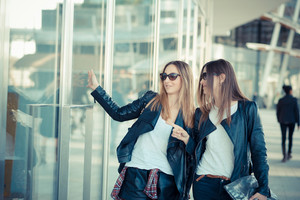 two beautiful young women shopping in the city