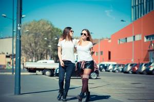 two beautiful young women walking in the city