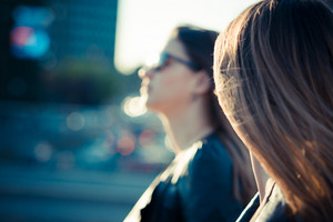 two blurred beautiful young women in the city