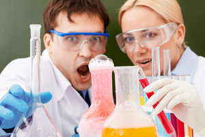 Two clinicians making scientific experiment in laboratory