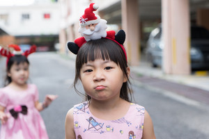 Two cute little girl wearing a tiara Christmas