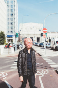 Two man wearing alien mask outdoor in the city - martian, carnival, halloween concept