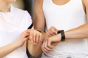 Two people using smart sport watch at workout