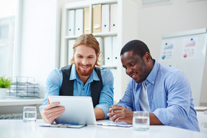 Two smiling businessmen networking in office