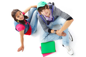 Two teenagers in casual clothes looking at camera