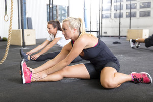 Two women stretching at the fitness gym