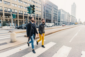 Two young bearded business man outdoor in the city walking - friendship, business concept
