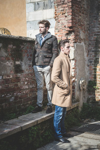 two young handsome fashion models men outdoors