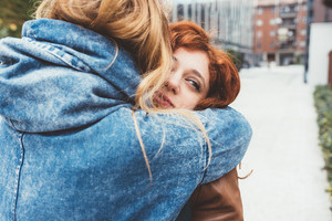 Two young women friends hugging outdoor - freidnship, love,